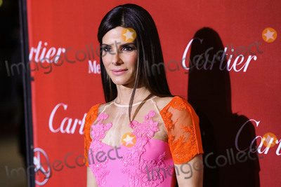 Alex Perry Photo - (FILE) Sandra Bullock Donates 6000 N95 Masks To Los Angeles Hospitals Amid Coronavirus COVID-19 Pandemic PALM SPRINGS RIVERSIDE CALIFORNIA USA - JANUARY 04 Actress Sandra Bullock wearing an Alex Perry dress Brian Atwood shoes and a Jimmy Choo purse arrives at the 25th Annual Palm Springs International Film Festival Awards Gala held at the Palm Springs Convention Center on January 4 2014 in Palm Springs Riverside California United States (Photo by Xavier CollinImage Press Agency)