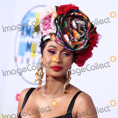 Dolce and Gabbana Photo - LOS ANGELES CA USA - OCTOBER 09 Rapper Cardi B aka Belcalis Marlenis Almanzar wearing a Dolce and Gabbana dress styled by Kollin Carter arrives at the 2018 American Music Awards held at the Microsoft Theatre LA Live on October 9 2018 in Los Angeles California United States (Photo by Xavier CollinImage Press Agency)