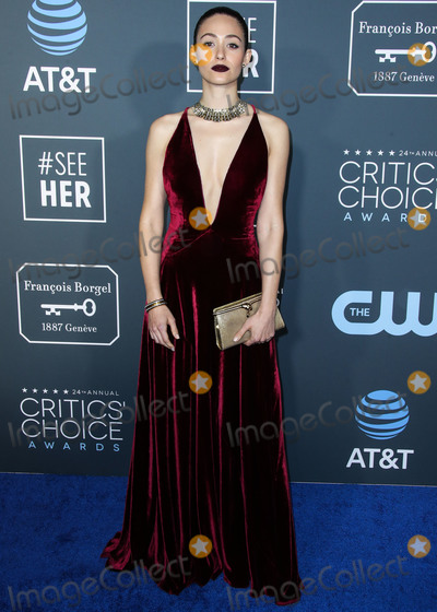 Emmy Rossum Photo - SANTA MONICA LOS ANGELES CA USA - JANUARY 13 Actress Emmy Rossum wearing a Ralph Lauren dress Fred Leighton jewelry Christian Louboutin shoes and a Bvlgari bag arrives at the 24th Annual Critics Choice Awards held at the Barker Hangar on January 13 2019 in Santa Monica Los Angeles California United States (Photo by Xavier CollinImage Press Agency)