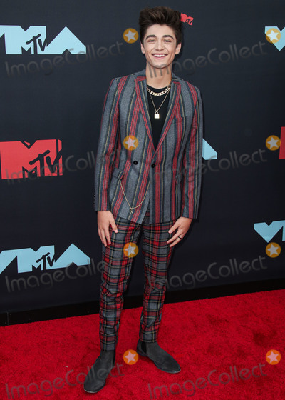 Asher Angel Photo - NEWARK NEW JERSEY USA - AUGUST 26 Asher Angel arrives at the 2019 MTV Video Music Awards held at the Prudential Center on August 26 2019 in Newark New Jersey United States (Photo by Xavier CollinImage Press Agency)