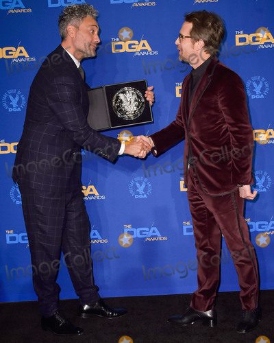 Sam Rockwell Photo - LOS ANGELES CALIFORNIA USA - JANUARY 25 Taika Waititi and Sam Rockwell pose in the press room at the 72nd Annual Directors Guild Of America Awards held at The Ritz-Carlton Hotel at LA Live on January 25 2020 in Los Angeles California United States (Photo by Image Press Agency)