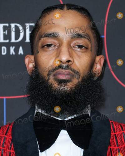 Madness Photo - (FILE) Rapper Nipsey Hussle killed in shooting outside his LA store LOS ANGELES CALIFORNIA USA - FEBRUARY 07 Rapper Nipsey Hussle (Ermias Asghedom) arrives at the Warner Music Pre-Grammy Party 2019 held at The NoMad Hotel Los Angeles on February 7 2019 in Los Angeles California United States (Photo by Xavier CollinImage Press Agency)