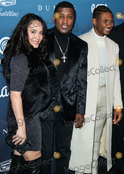 Usher Photo - LOS ANGELES CA USA - JANUARY 05 Nicole Pantenburg Babyface (Kenneth Brian Edmonds) and Usher (Usher Raymond IV) arrive at The Art Of Elysiums 12th Annual Heaven Gala held at a Private Venue on January 5 2019 in Los Angeles California United States (Photo by Xavier CollinImage Press Agency)