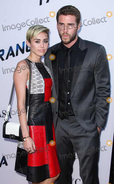 Cake Photo - (FILE) Miley Cyrus and Liam Hemsworth Appear to Be Married Miley Cyrus and Liam Hemsworth appeared to have tied the knot six years after getting engaged Miley Cyrus and Liam Hemsworth are believed to have tied the knot in a low-key ceremony at home The singer 26 and actor 28 who got engaged six years ago have been seen cutting their wedding cake in a series of photos on social media LOS ANGELES CA USA - AUGUST 08 Singer Miley Cyrus and boyfriendactor Liam Hemsworth arrive at the Los Angeles Premiere Of Relativity Medias Paranoia held at the Directors Guild of America Theatre on August 8 2013 in Los Angeles California United States (Photo by Xavier CollinImage Press Agency)