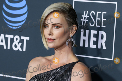 Givenchy Photo - (FILE) Charlize Theron Announces 1 Million Dollar Donation Amid Coronavirus COVID-19 Pandemic Charlize Theron has donated 1 million dollars to the coronavirus relief efforts through her foundation The Charlize Theron Africa Outreach Project and partners CARE and the Entertainment Industry Foundation (EIF) SANTA MONICA LOS ANGELES CALIFORNIA USA - JANUARY 13 Actress Charlize Theron wearing a Givenchy dress Christian Louboutin shoes and Messika jewelry arrives at the 24th Annual Critics Choice Awards held at the Barker Hangar on January 13 2019 in Santa Monica Los Angeles California United States (Photo by Xavier CollinImage Press Agency)