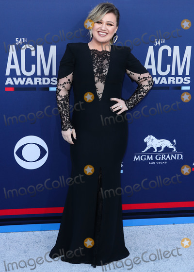 Yves Saint Laurent Photo - LAS VEGAS NEVADA USA - APRIL 07 Singer Kelly Clarkson wearing an Alexander McQueen dress Yves Saint Laurent earrings and Balmain shoes arrives at the 54th Academy Of Country Music Awards held at the MGM Grand Garden Arena on April 7 2019 in Las Vegas Nevada United States (Photo by Xavier CollinImage Press Agency)