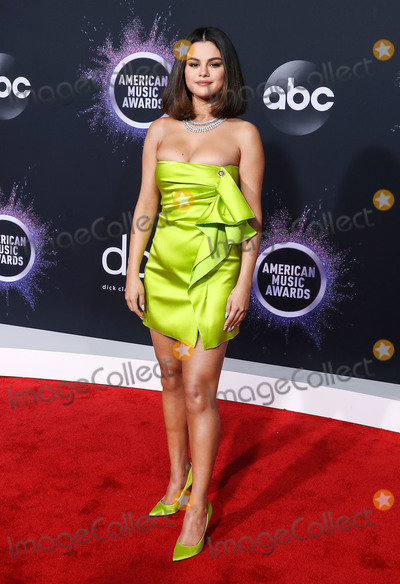 Selena Gomez Photo - LOS ANGELES CALIFORNIA USA - NOVEMBER 24 Singer Selena Gomez wearing a Versace dress and shoes with Roberto Coin jewelry arrives at the 2019 American Music Awards held at Microsoft Theatre LA Live on November 24 2019 in Los Angeles California United States (Photo by Xavier CollinImage Press Agency)