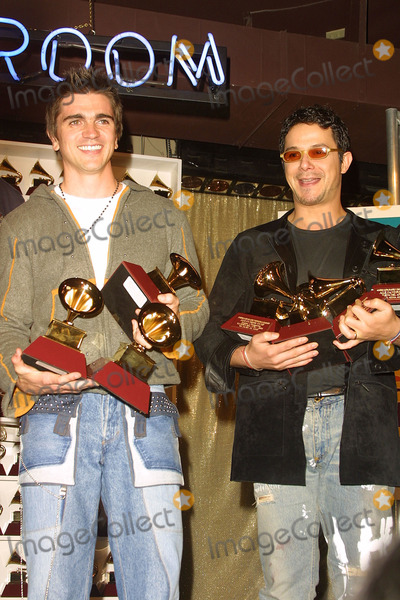 Alexandro Sanz Photo - Juanes and Alexandro Sanz Hold Their Grammys 2nd Latin Grammy Awards Conga Room Los Angeles CA October 30 2001 Photo by Nina PrommerGlobe Photos Inc 2001 K23232np (D)