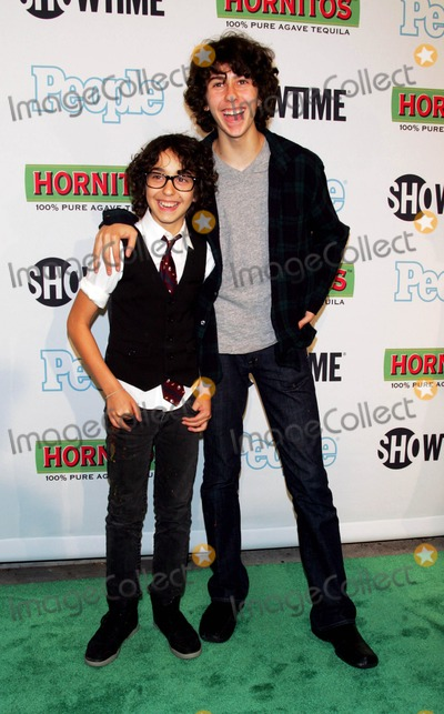 Alex Wolff Photo - The Naked Brothers Band - Nat (R) and Alex Wolff Arrive For the Premiere of Bon Jovi When We Were Beautiful at the Sva Theater in New York on October 21 2009 Photo by Sharon NeetlesGlobe Photos Inc
