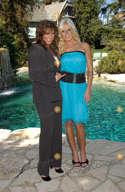Stephanie McMahon Photo -  World Wrestling Superstar Torrie Wilson Appears in Playboys May Issue Press Conference at the Playboy Manson in Beverly Hills CA 3262003  Photo by Fitzroy Barrett  Globe Photos Inc 2003 Stephanie Mcmahon and Torrie Wilson