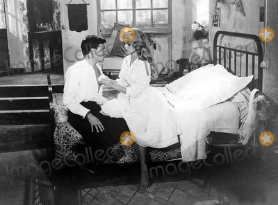Jean-Louis Trintignant Photo - Jean Louis Trintignant and Brigitte Bardot in a Scene From and God Created Woman Globe Photos Inc