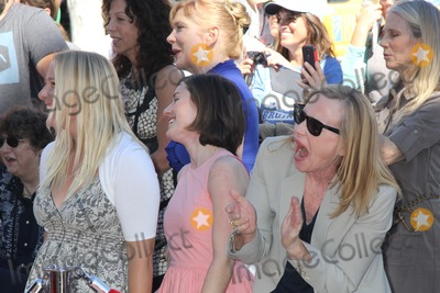 Amy Madigan Photo - Ed Harris Honored with Star on the Hollywood Walk of Fame 6712 Hollywood Boulevard in Front of the Historic Egyptian Theatre Hollywood CA 03132015 Amy Madigan and Lily Dolores Harris Clinton H WallaceipolGlobe Photos