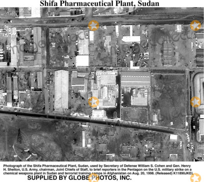 Train Photo - 980820-O-0000X-005Photograph of the Shifa Pharmaceutical Plant Sudan used by Secretary of Defense William S Cohen and Gen Henry H Shelton US Army chairman Joint Chiefs of Staff to brief reporters in the Pentagon on the US military strike on a chemical weapons plant in Sudan and terrorist training camps in Afghanistan on Aug 20 1998  (Released)