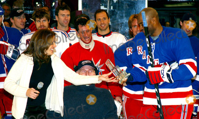 Amani Toomer Photo - Superskate Vi a Celebrity Hockey Event to Benefit Rangers Cheering For Children and Crpf at Madison Square Garden in New York City 1252004 Photo Byrick MacklerrangefindersGlobe Photos Inc 2004 Christopher Reeve and Wife Dana Reeve with Amani Toomer