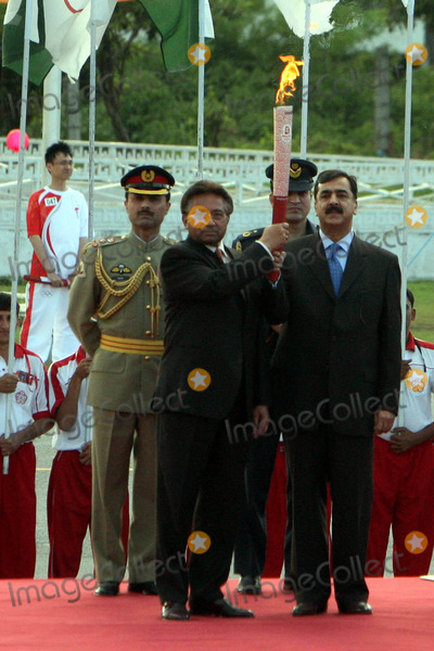 Pervez Musharraf Photo - Apr 16 2008 Islamabad Pakistan Pakistans President Pervez Musharraf(l) and Prime Minister Yousaf Raza Gilani Jointly Hold the Olympic Torch During a Ceremony Atmosphere Photo by Top Photo-Globe Photos Inc