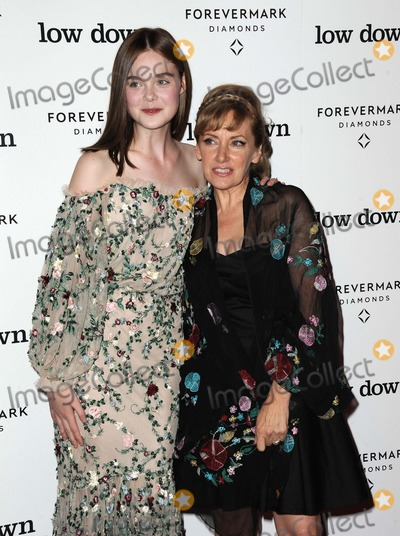 Amy-Jo Albany Photo - Elle Fanning Amy-jo Albany attending the Los Angeles Premiere of Low Down Held at the Arclight Theater in Hollywood California on October 23 2014 Photo by D Long- Globe Photos Inc