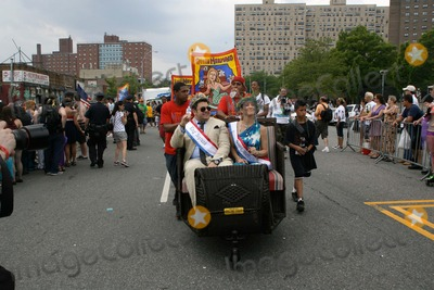Cat Greenleaf Photo - Coney Island Mermaid Parade Brooklyn NY King Neptune Adam Richman and   Queen Mermaid Cat Greenleaf                                                                                                           Bruce Cotler - Globe Photos                      6  18  11