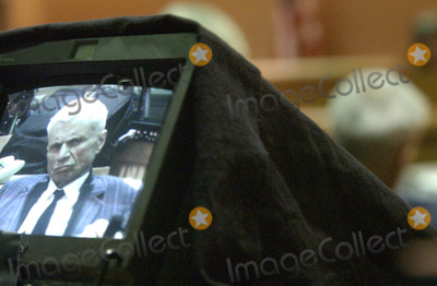 Bonnie Lee Bakley Photo - 060434ME0226blake4MJC -- A Court TV monitor shows the facial reactions of Robert Blake during the playing of a secret audiotape made by Bonny Lee Bakley talking about her pregnancy on the first day of the Blake preliminary hearing POOL PHOTOGLOBE PHOTOS INCK2929702272003
