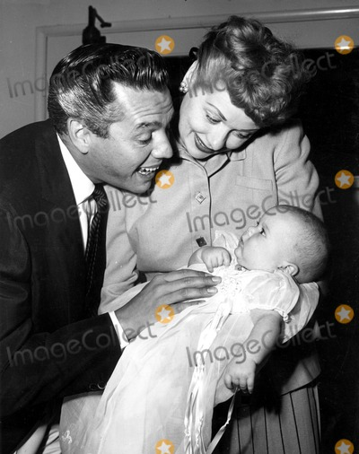 Desi Arnaz Photo - Lucille Ball and Desi Arnaz with Son Desi Jr on His Christening Day Supplied by SmpGlobe Photos Inc