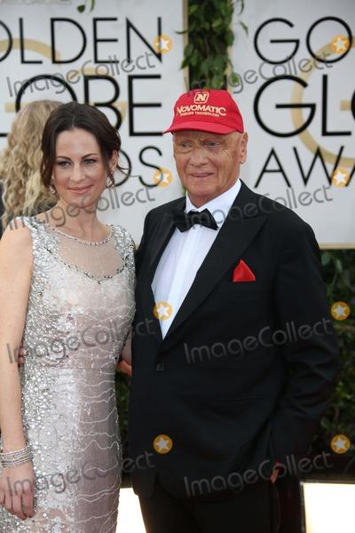 Niki Lauda Photo - Niki Lauda and Wife Birgit Wetzinger Attend the 71st Annual Golden Globe Awards Aka Golden Globes at Hotel Beverly Hilton in Los Angeles USA on 12 January 2014 Photo Alec Michael-Globe Photos Inc