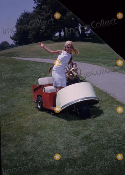 Jackie Gleason Photo - Tuesday Weld with Jackie Gleason 1963 Photo by William Claxton-Globe Photos Inc
