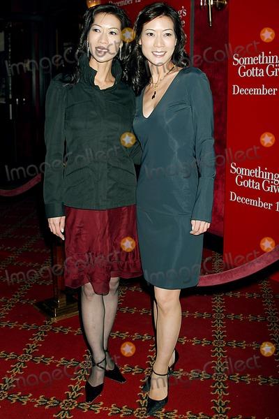 Ada Tai Photo - Somethings Gotta Give Premiere at the Ziegfeld Theatre New York City 12032003 Photo Sonia Moskowitz Globe Photos Inc 2003 Ada Tai and Arlene Tai