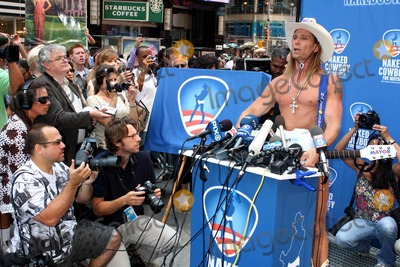 Robert John Burck Photo - Naked Cowboy Robert John Burck Launches Campaign For Mayor of New York City in Times Square  New York 07-22-2009 Photo by John Barrett-Globe Photos Inc