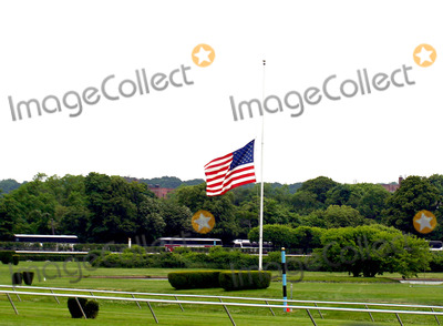 American Flag Photo - 136th Belmont Stakes (Race) at the Belmont Race Track in Elmont New York 652004 Photo Bywilliam ReganGlobe Photos Inc 2004 American Flag at Half Staff For Former President Ronald Reagan