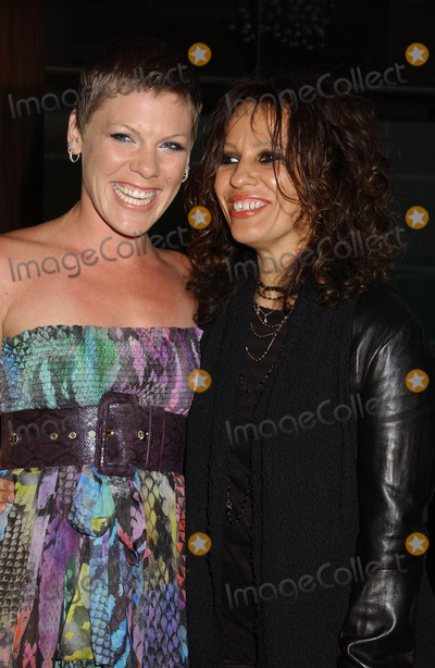 Alecia Moore Photo - PINK (AKA ALECIA MOORE) and Linda Perrythe LA Gay and Lesbian Centers AN EVENING WITH WOMEN CELEBRATING ART MUSIC AND EQUALITY held at the Beverly Hilton Hotel Beverly Hills California 05-01-2010Photo by Phil Roach-IPOL-Globe Photos Inc 2010I15208PR
