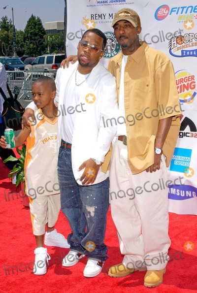 Ralph Tresvant Photo - Lincoln Presents 19th Annual a Midsummer Nights Magic Celebrityall-star Basketball Game at the Forum in Inglewood California 08012004 Photo by Valerie GoodloeGlobe Photos Inc 2004 Ralph Tresvant Michael Bivins and His Son