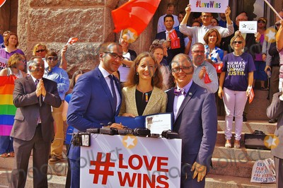 Jim Obergefell Photo - Approximately 150 People Gathered on the North Steps of the Texas State Capitol on 06292015 to Support the Recent Supreme Court Ruling on Gay Marriage and to Protest Recent Statements by Texas State Attorney Ken Paxton and Governor Greg Abbott That Wedding Officials in Texas Could Refuse to Perform Ceremonies For Same Sex Couples If They Held Religious Objectionaustin Mayor Pro Tem Kathy Tovo Officially Proclaims 06292015 to Be Marriage Equality Day in the City of Austin Flanked by Chad Griffin President of the Human Rights Campaign on Left and Scotus Plaintiff Jim Obergefeller on Rightphoto by Jeff J NewmanGlobe Photos
