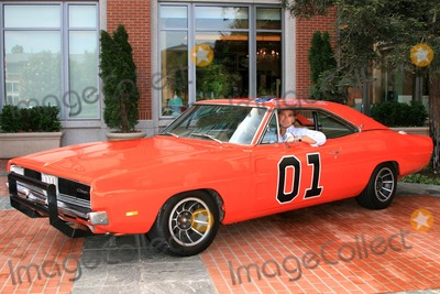 GENERAL LEE Photo - JOHN SCHNEIDER -JOHN SCHNEIDER RAISES MONEY FOR THE OAK CHRISTIAN SCHOOL IN WESTLAKE VILLAGE -DEBORAH SAGE ROCKEFELLER BID 4000 AND WON A RIDE IN THE GENERAL LEE CAR FROM DUKES OF HAZARD WITH JOHN SCHNEIDER WHO RECENTLY LOST OUT ON HIS EBAY BIDDER TO RAISE MONEY FOR HIS NEXT FILM -WESTLAKE VILLAGE CALIFORNIA - 05-12-2007 -PHOTO BY NINA PROMMERGLOBE PHOTOS INC 2007K52970NP