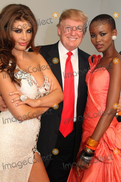 Angela Martini Photo - Donald Trump Poses with Famous Former Miss Universe Beauty Queens Chelsea Piers Pier 59 Studios NYC July 27 2011 Photos by Sonia Moskowitz Globe Photos Inc 2011 Angela Martini Miss Albania 2010 Donald Trump Flaviana Matata Miss Tanzania