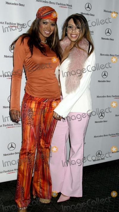 Traci Bingham Photo - Single Celebrity Arrivals at Mercedes Benz Spring 2005 Fashion Week at Smashbox Studios Culver City CA 10262004 Photo by Clinton H WallaceipolGlobe Photos Inc 2004 Traci Bingham and Sister Jenna
