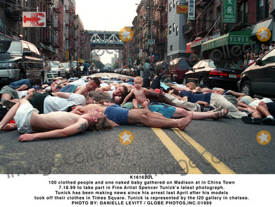 Spencer Tunick Photo - K16162DL100 clothed people and one naked baby gathered on Madison st in China Town 71899 to take part in Fine Artist Spencer Tunicks latest photograph Tunick has been making news since his arrest last April after his models took off their clothes in Times Square Tunick is represented by the I20 gallery in chelseaPHOTO BY DANIELLE LEVITT  GLOBE PHOTOSINC  1999