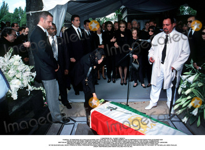 As Yet Photo - IMAPRESS PH  CLEMOT  BENITOFUNERAL OF PRINCESS LEILA PAHLAVI IN PARIS 16TH JUNE 2001 IN TOTAL BEREAVEMENT THE EX-EMPRESS OF IRAN FARAH PAHLAVI BURIED HER DAUGHTER IN THE PASSY CEMETERY IN PARIS LEILA PAHLAVI 31 PASSED AWAY A WEEK AGO IN LONDON THE OFFICIAL COMMUNIQUE WRITTEN BY HER MOTHER INDICATED THAT SHE PASSED AWAY IN HER SLEEP BUT THE EXACT CIRCUMSTANCES OF THE DEACEASED REMAIN AS YET UNKNOWNPRINCESS YASMINE PLACES A HEART SHAPED BOX CONTAINING A MESSAGE FROM HER DAUGHTERS NOOR AND IMAN TO THEIR AUNT IN THE BACKGROUND REZA II PRINCE ALI REZA PRINCESS FARAHNAZ EMPRESS FARAH PRINCESS ASHRAF THE SHAHS TWIN SISTER AND TO THE RIGHT OF THE MOLLAH ABDO PAHLAVICREDIT IMAPRESSCLEMOTBENITOGLOBE PHOTOS INC