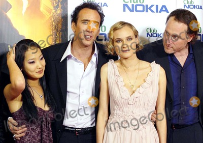 Alice Kim Cage Photo - Alice Kim Nicholas Cage  Diane Kruger Jon Turtletaub National Treasure Premiere -Palacio DE LA Musica Madrid Spain 10-26-2004 Photo Byrobert Calanda-globelinkuk-Globe Photos Inc 2004
