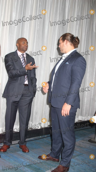 Amani Toomer Photo - Exclusive L-r Amani Toomer Markus Kuhn attends the 22nd Annual Gridiron Gala at New York Hilton Midtown Hotel on 5122015 in NYC