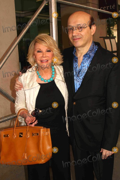 Norm Zada Photo - K14465BTJoan Rivers got more than she expected when she recently went to millionaire Norm Zadas mansion to tape an episode of her new TV Land reality series Hows You Get So Rich The millionaire bachelor creator of Perfect 10 magazine fell smitten with Rivers and as a surprise flew to Manhattan to take her to lunch at Michaels restaurant 08-17-2009Photo by Barry Talesnick-IPOL-Globe Photos incJOAN RIVERS and NORM ZADA
