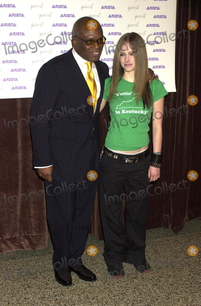 Avril Lavigne Photo - an Evening to Benefit Pencil and New York City Schools at the Hammerstein Ballroom in New York City 11182002 Photo by John KrondesGlobe Photos Inc 2002 Antonio Reid and Avril Lavigne