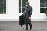 Photos From A man carrying a portfolio passes by the West Wing