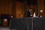 Photo - United States Senator Ben Sasse (Republican of Nebraska) speaks on his cell phone after arriving to a Senate Finance Committee hearing for Janet L Yellen of California President-elect Joe Bidens nominee for Treasury Secretary in Washington DC January 19th 2021Credit Anna Moneymaker - Pool via CNPAdMedia