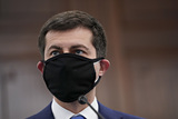 Photo - Pete Buttigieg US secretary of transportation nominee for US President Joe Biden wears a protective mask during a Senate Commerce Science and Transportation Committee confirmation hearing in Washington DC US on Thursday Jan 21 2021 Buttigieg is pledging to carry out the administrations ambitious agenda to rebuild the nations infrastructure calling it a generational opportunity to create new jobs fight economic inequality and stem climate change Credit Stefani Reynolds  Pool via CNPAdMedia