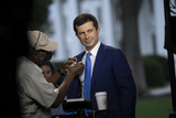 Photos From United States Secretary of Transportation Pete Buttigieg participates in a television interview at the White House