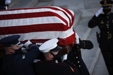 Photo - A casket containing the remains of late US Capitol Police officer William Evans who was killed in the line of duty on April 2 is carried as it departs the US Capitol following ceremonies in his honor in Washington US April 13 2021 Credit Carlos Barria  Pool via CNPAdMedia