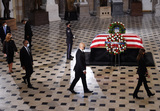 Photo - Mourners surround the casket of the late Associate Justice Ruth Bader Ginsburg in the Statuary Hall where she lie in state at the US Capitol September 25 2020 in Washington DCCredit Olivier Douliery  Pool via CNPAdMedia
