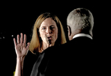 CLARENCE THOMAS Photo - Associate Justice of the Supreme Court Clarence Thomas administers the oath of office to Judge Amy Coney Barrett to be Associate Justice of the Supreme Court on the South Lawn of the White House in Washington DC on Monday October 26 2020  Credit Ken CedenoPool via CNPAdMedia