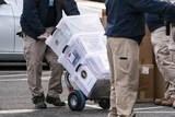 Photo - Workers move boxes onto a truck that were stacked on West Executive Avenue between the White House and the Eisenhower Executive Office Building in Washington DC USA 14 January 2021Credit Jim LoScalzo  Pool via CNPAdMedia