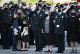 Photo - WASHINGTON DC - APRIL 13 Logan Evans son ShannonTerranova wife Abigail Evans daughter and Janice Evans mother watch and react as Capitol Police Officer William Billy Evans is carried out after laying in Honor on Capitol Hill on Tuesday April 13 2021 in Washington DCCredit Jabin Botsford  Pool via CNPAdMedia