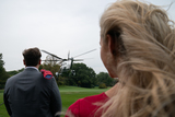 Photo - Visitors watch as Marine One carrying US President Donald Trump departs the South Lawn of the White House  in Washington DC US on Thursday September 24 2020 Credit Erin Scott  Pool via CNPAdMedia